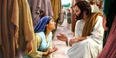 Een vrouw die voor Jezus neerknielt. Hij hurkt om met haar te praten