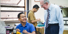 Denton Hopkinson talks to a young Bethelite at the Philippines branch office