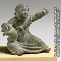 A Greek or Roman statuette of a child with a puppy