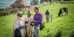 A brother shares the Kingdom message with two villagers in Ethiopia