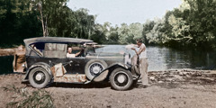George Rollston and Arthur Willis fill their car's radiator in the Northern Territory of Australia in 1933