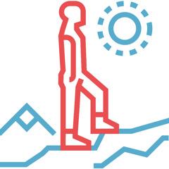 Un hombre escalando una montaña