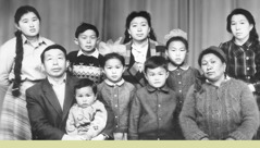 Beishenbai Berdibaev and his wife with eight of their children