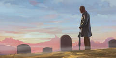 A man stands in a cemetery