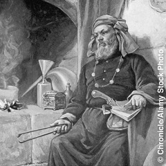 A medieval alchemist in his laboratory
