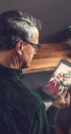 One of the scientists referred to earlier holds a picture of the older couple in the opening article