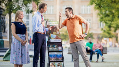 When a man opposes a couple at a public witnessing cart, they act in a mild, respectful manner