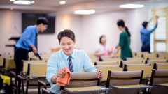 Brothers and sisters clean a Kingdom Hall