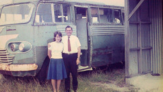 Winston and Pam Payne stand beside a bus, one of their accommodations while in circuit work