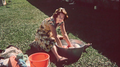 In Tonga, Pam washes clothes using a tub and a bucket