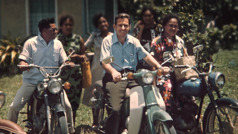 Winston takes a group, all of whom are on motorcycles, in service on Niue Island