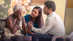 A Witness couple comfort a grieving relative who has lost a loved one