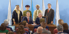 A group of world leaders prepare to sign a document