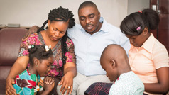 A father prays with his family