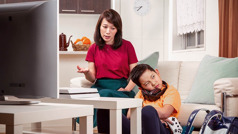 A mother calmly reasons with her son because he has played video games instead of doing chores and schoolwork