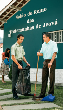 A brother helps clean the Kingdom Hall