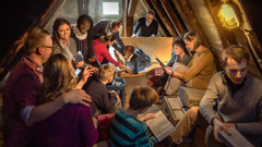 Brothers and sisters encourage one another in an attic during the great tribulation
