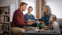 During family worship, the same Witness father uses the Bible to strengthen his family's faith