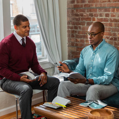 The same man is studying the Bible at his home with one of Jehovah's Witnesses.