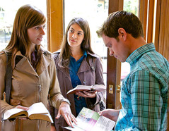 Jehovah's Witnesses discuss a subject from a magazine with a man