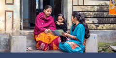 A sister preaches to a mother and daughter in the state of West Bengal in India