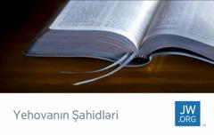 jw.org saytının vizit kartının üzərində açıq Müqəddəs Kitab şəkli