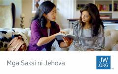 Sarong jw.org contact card na ipinapahiling an saro sa mga Saksi ni Jehova na nagbabasa nin Bibliya sa sarong tawo