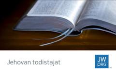 Käyntikortti, jossa on auki oleva Raamattu