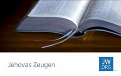 Eine Kontaktkarte für jw.org, auf der man eine geöffnete Bibel sieht