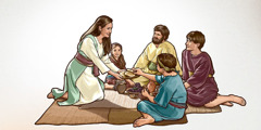 A woman in Bible times passes food to her family
