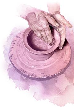 Seorang tukang tembikar membentuk tanah liat