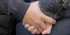 A man and a woman hold hands