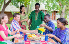 People of various nationalities enjoy a picnic together
