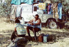 A circuit overseer in Africa writes a report at his campsite