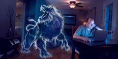 Un irmán co seu ordenador ten detrás un león ruxindo, que representa aSatán