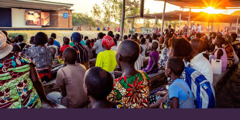 Convention delegates in Malawi gather in the evening to watch JW Broadcasting