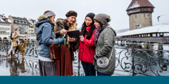 Sisters use a tablet to do public witnessing in Switzerland