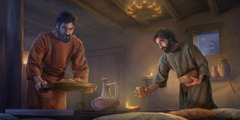 Pedro y Juan ponen el pan y las copas en la mesa.