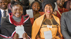 Sisters and a brother holding the newly released 'New World Translation' in Xhosa.