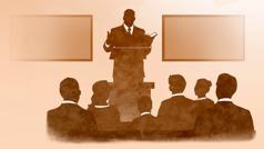 An elder giving a talk at a congregation meeting.