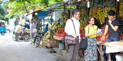 Two of Jehovah's Witnesses preach in a marketplace in Indonesia
