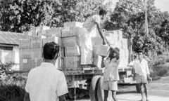 A shipment of Paradise books is unloaded in Indonesia, 1963