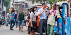 Jehovah's Witnesses preach at a market in Jakarta