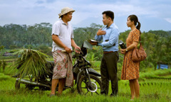 Jehovah's Witnesses preach to a man in the Indonesian countryside