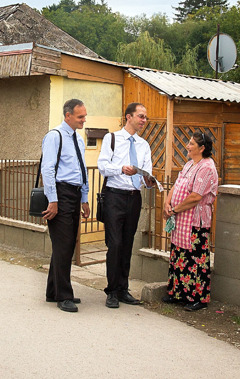 Two of Jehovah's Witnesses in Slovakia preach to a Roma woman
