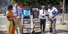 Jehovah's Witnesses stand beside literature carts and preach to people in Dar es Salaam, Tanzania