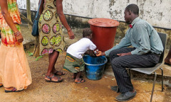 A hand-washing station outside a Kingdom Hall in West Africa