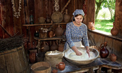 A woman makes bread