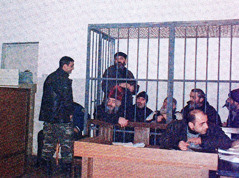 Members of the extremist Orthodox group and their leader, Vasili Mkalavishvili, under arrest