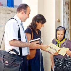 Jehovah's Witnesses teaching an elderly woman about God